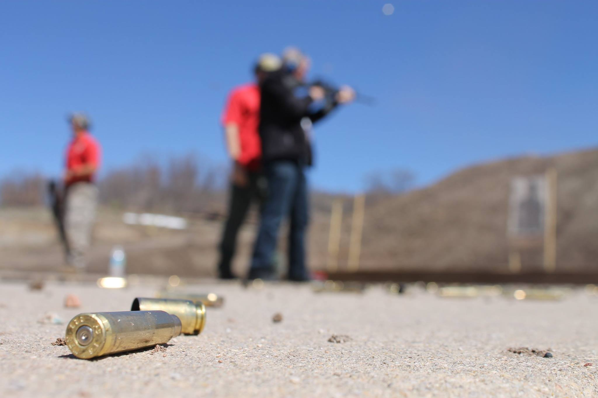 A photo of a citizens academy student at the shooting range