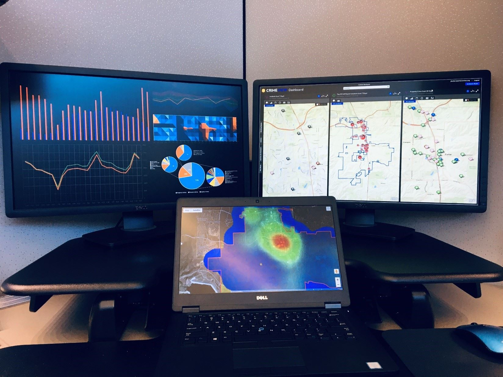Photo of multiple computer monitors with crime data